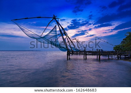 Traditional chinese fishing net at Fort Cochin, India - stock photo