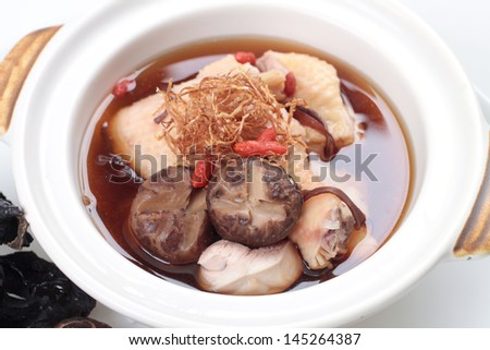 Traditional Chinese Meat Soup In Herb Stock In Claypot - stock photo