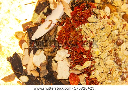 traditional chinese medicinal materials--Rehmannia glutinosa, Carthamus tinctorius,Astragalus membranaceus, Angelica sinensis - stock photo