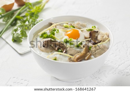 Traditional chinese porridge rice gruel in bowl, congee. - stock photo