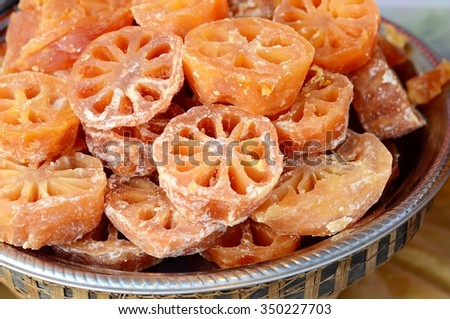 traditional Chinese snack. herbal medicine. slices of sweeten lotus roots. - stock photo