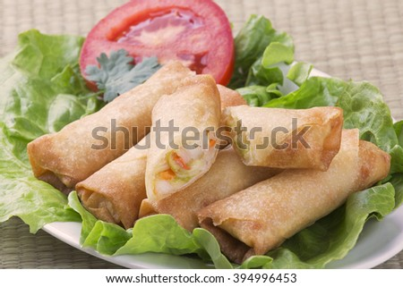 Traditional Chinese Spring Rolls showing inside of appetizer - stock photo