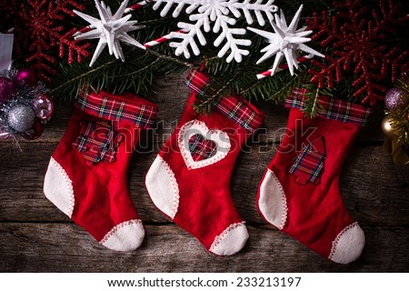 Traditional Christmas red and white sock on wooden background  - stock photo