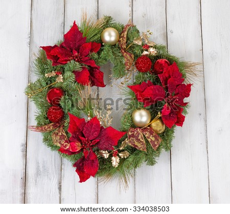 Traditional Christmas wreath on rustic white wood. Boards in vertical pattern.   - stock photo