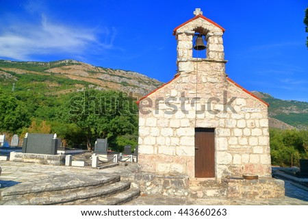 Traditional church and cemetery from the Adriatic sea area, Montenegro - stock photo