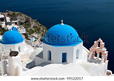 Traditional church and steeple at Oia village of Santorini island in Greece - stock photo