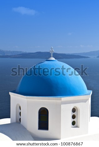 Traditional church with blue cupola at Santorini island in Greece - stock photo