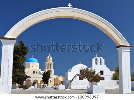 Traditional churches at Oia village of Santorini island in Greece - stock photo