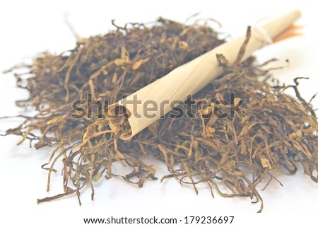 Traditional cigarettes and tobacco isolated on white background - stock photo