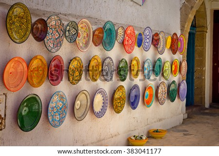 Traditional colorful Moroccan plates on the street walls of Marrakesh. - stock photo