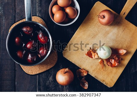 Traditional coloring Easter eggs with onion - stock photo