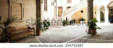 Traditional courtyard with chairs and a lot o flowers in Palma de Majorca, Mallorca island, Spain - stock photo