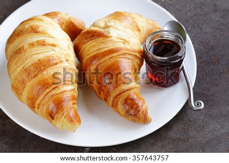 traditional croissants with jam for breakfast - stock photo
