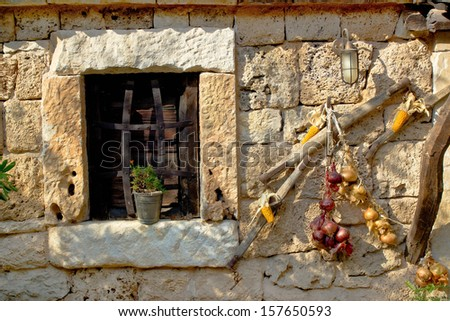 Traditional dalmatian stone house window with ornaments, Dalmatia, Croatia - stock photo