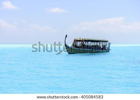 Traditional Dhoni boat in Maldives - stock photo