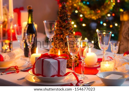 Traditional dishware on Christmas table - stock photo