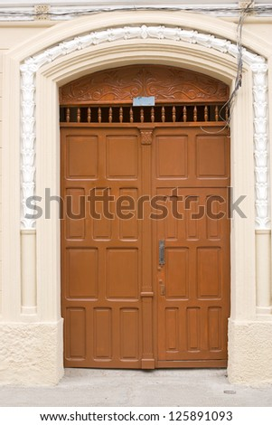 Traditional Door in Old Colonial wall,brown - stock photo