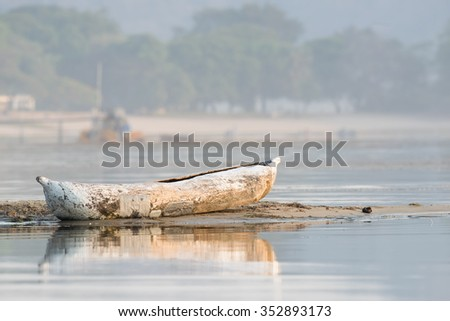 Traditional dugout resting on shore of Lake Malawi - stock photo