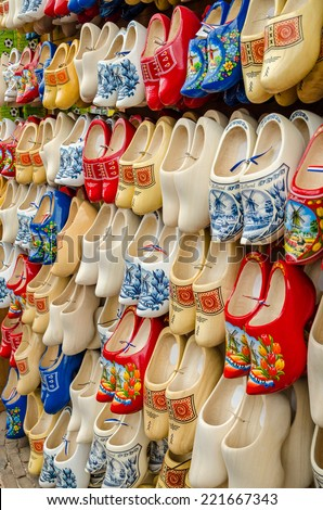 Traditional Dutch clogs wooden shoes in a souvenir store in Amsterdam - stock photo