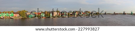 Traditional dutch colorful authentic town and windmills river landscape. Zaanse schans windmills panoramic landscape. Zaanse Schans, Netherlands  - stock photo