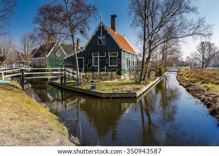 Traditional Dutch old wooden windmill in Zaanse Schans - stock photo