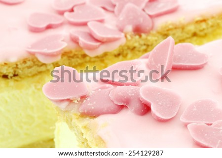 """Traditional Dutch pastry called """"tompouce"""" with pink icing and pink candy hearts especially produced for  valentine's day in Holland   - stock photo"""