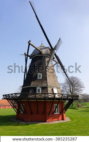 Traditional dutch windmill. Brown windmill. Closeup windmill. Windmill in Copenhagen. Windmill at sunny day. 18th century windmill in Copenhagen. - stock photo