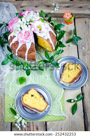 Traditional easter cake decorated with icing and flowers - stock photo