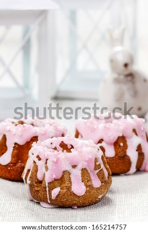 Traditional easter yeast cake covered with pink icing and colorful sprinkles - stock photo