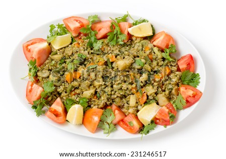Traditional Egyptian freek vegetable pilaf, with the roasted wheat grain taking the place of rice, as freekeh (or frikeh) is cooked in stock with chopped veg, seen from above. - stock photo