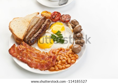Traditional English breakfast - egg, sausages, beans and bacon - stock photo
