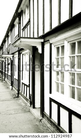 Traditional english houses with timber beams in monochrome - stock photo