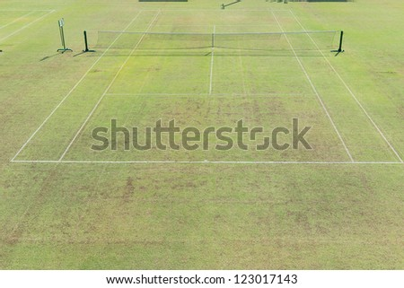 Traditional english out door grass tennis court, taken on a sunny day - stock photo