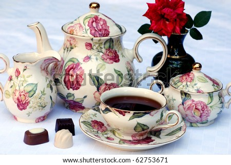 Traditional english tea with floral dishware and rose.Selective focus - stock photo