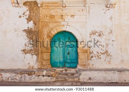 Traditional entrance door blue colour, Mahdia, Tunisia - stock photo