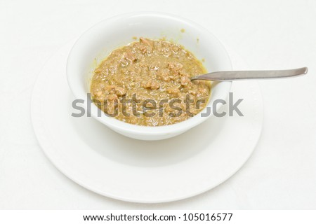 Traditional Ethiopian alica wot (curry stew) served in a bowl. - stock photo