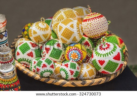 Traditional ethnic African handmade colorful bead toys balls. Decorations. Unique craftsmanship. Local craft market in South Africa. - stock photo