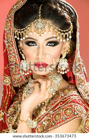 Traditional ethnic bride in costume with heavy jewellery - stock photo
