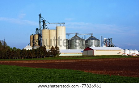 traditional farm with silo in Southwestern Ontario - stock photo