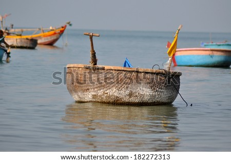 Traditional fishing boats in Mui Ne, Vietnam - stock photo