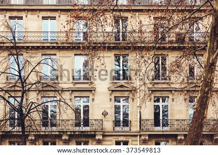Traditional French Architecture with Typical Windows and Balconies in Paris. Autumn in France.  - stock photo