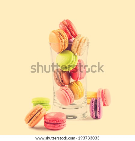 traditional french colorful macarons in a glass on vintage background - stock photo