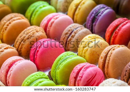 traditional french colorful macarons in a rows in a box - stock photo