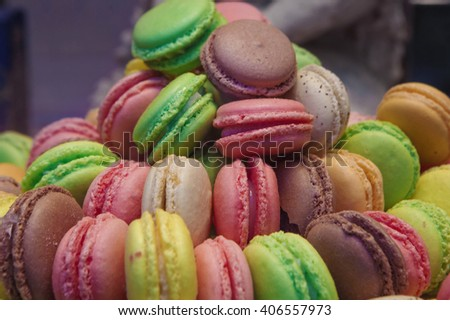 traditional french colorful macarons in market  - stock photo