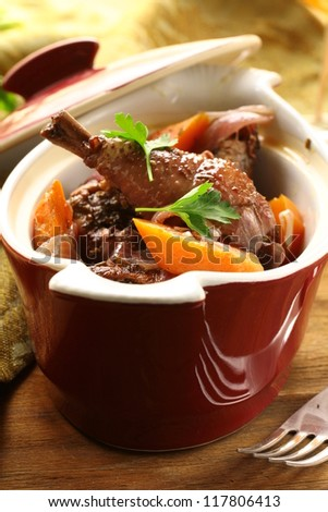 Traditional French cuisine - chicken in wine, coq au vin - stock photo