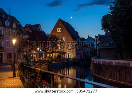 Traditional french houses on the side of chanel Petite Venise, Colmar, France, at night - stock photo