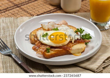 Traditional French Toasted Sandwich with fried eggs - Croque Madame. Selective focus. - stock photo