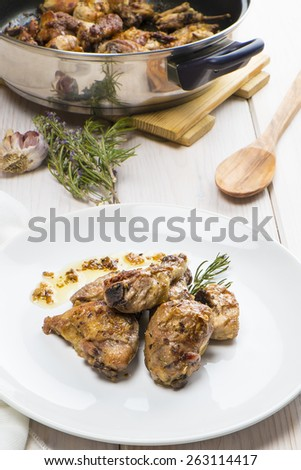 Traditional garlic Chicken dish Spanish style on the table - stock photo