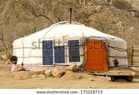 traditional ger / Yurt in mongolia has Solar energy panels attached to the ger to provide energy for the family inside. A perfect way for nomads to have energy in the desert or steppe. - stock photo
