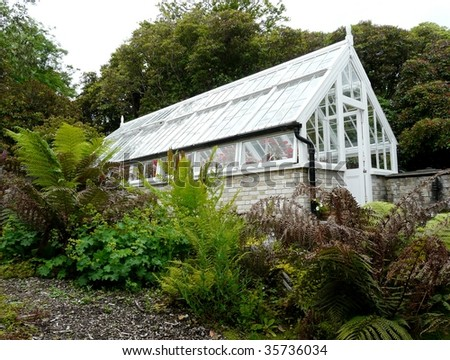 Traditional glass greenhouse or hothouse - stock photo